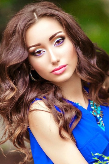 Ukrainian girl Olechka,22 years old with brown eyes and light brown hair.