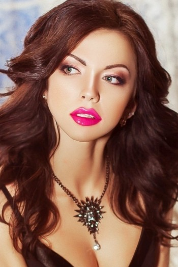 Ukrainian girl Alexandra ,24 years old with green eyes and dark brown hair.