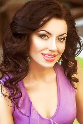 Ukrainian girl Elena ,34 years old with blue eyes and dark brown hair.