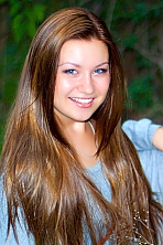 Ukrainian girl Alina,21 years old with grey eyes and light brown hair.