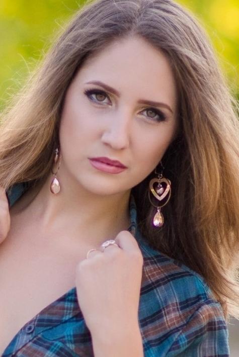 Ukrainian girl Ludmila,21 years old with brown eyes and dark brown hair.