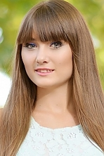 Ukrainian girl Viktoriya,23 years old with green eyes and dark brown hair.