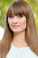 Ukrainian girl Viktoriya,22 years old with green eyes and dark brown hair.