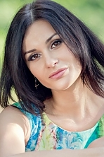 Ukrainian girl Olga,32 years old with brown eyes and black hair.