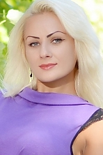 Ukrainian girl Inna,31 years old with grey eyes and blonde hair.