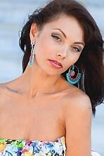 Ukrainian girl Juliya,29 years old with hazel eyes and black hair.