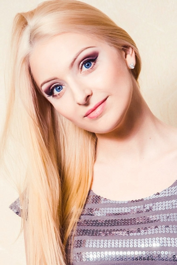 Ukrainian girl Olga,28 years old with blue eyes and blonde hair.