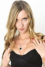 Russian girl Alla,32 years old with blue eyes and blonde hair.
