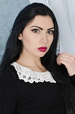 Ukrainian girl Julia,21 years old with blue eyes and black hair.