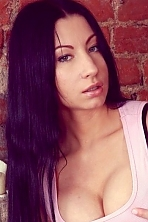 Russian girl Tatiana,24 years old with green eyes and black hair.