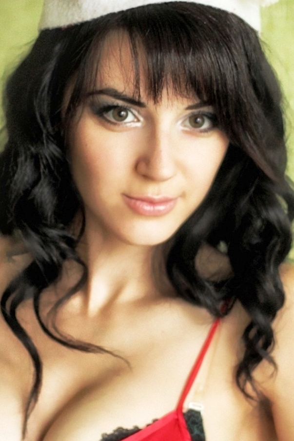 Ukrainian girl Maria,27 years old with green eyes and black hair.
