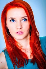 Ukrainian girl Jana,22 years old with blue eyes and red hair.