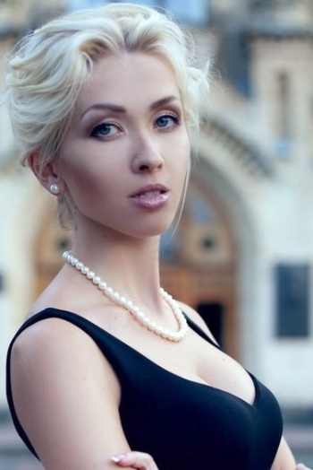 Ukrainian girl Elena,28 years old with green eyes and blonde hair.