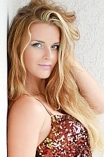 Ukrainian girl Alla,34 years old with green eyes and blonde hair.
