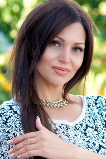 Ukrainian girl Victoria,42 years old with brown eyes and black hair.