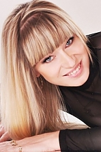 Ukrainian girl Irina,46 years old with grey eyes and blonde hair.