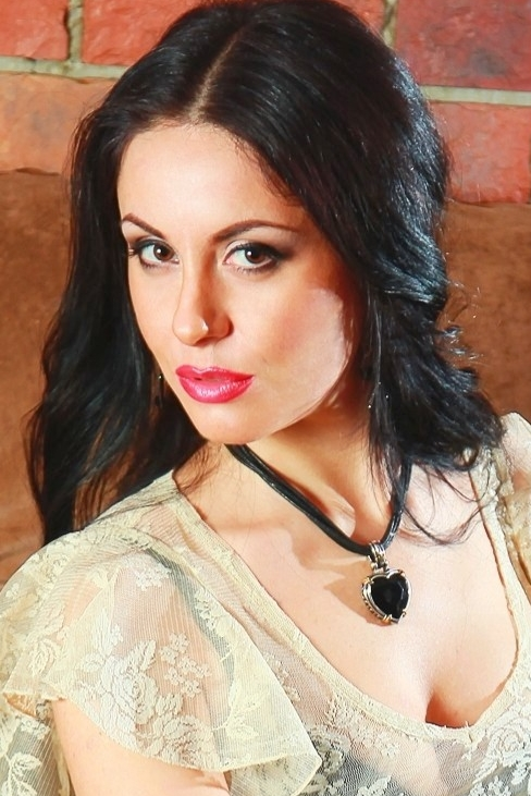 Ukrainian girl Irina,27 years old with brown eyes and black hair.