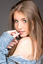 Ukrainian girl Ruslana,21 years old with blue eyes and light brown hair.