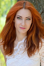Ukrainian girl Valeria,28 years old with green eyes and red hair.