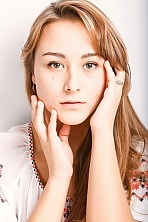 Ukrainian girl Olya,22 years old with green eyes and light brown hair.