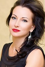 Ukrainian girl Angela,45 years old with blue eyes and black hair.
