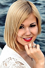 Ukrainian girl Alexandra,22 years old with brown eyes and blonde hair.