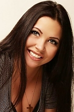 Ukrainian girl Alina,27 years old with green eyes and black hair.
