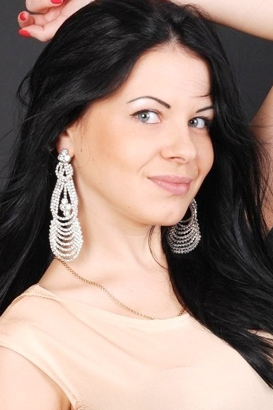 Ukrainian girl Elena,27 years old with hazel eyes and black hair.