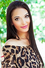 Ukrainian girl Tanya,21 years old with brown eyes and black hair.