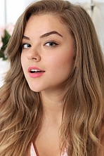 Ukrainian girl Kristy,23 years old with green eyes and light brown hair.