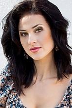 Ukrainian girl Anastasia,24 years old with green eyes and black hair.