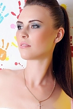 Ukrainian girl Alexandra,33 years old with grey eyes and dark brown hair.