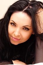 Ukrainian girl Ruslana,35 years old with green eyes and black hair.