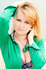 Ukrainian girl Maria,29 years old with green eyes and red hair.