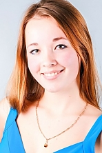 Ukrainian girl Ludmila,21 years old with green eyes and light brown hair.
