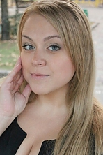 Ukrainian girl Anna,27 years old with grey eyes and blonde hair.