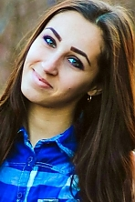 Ukrainian girl Tatiana,22 years old with green eyes and dark brown hair.