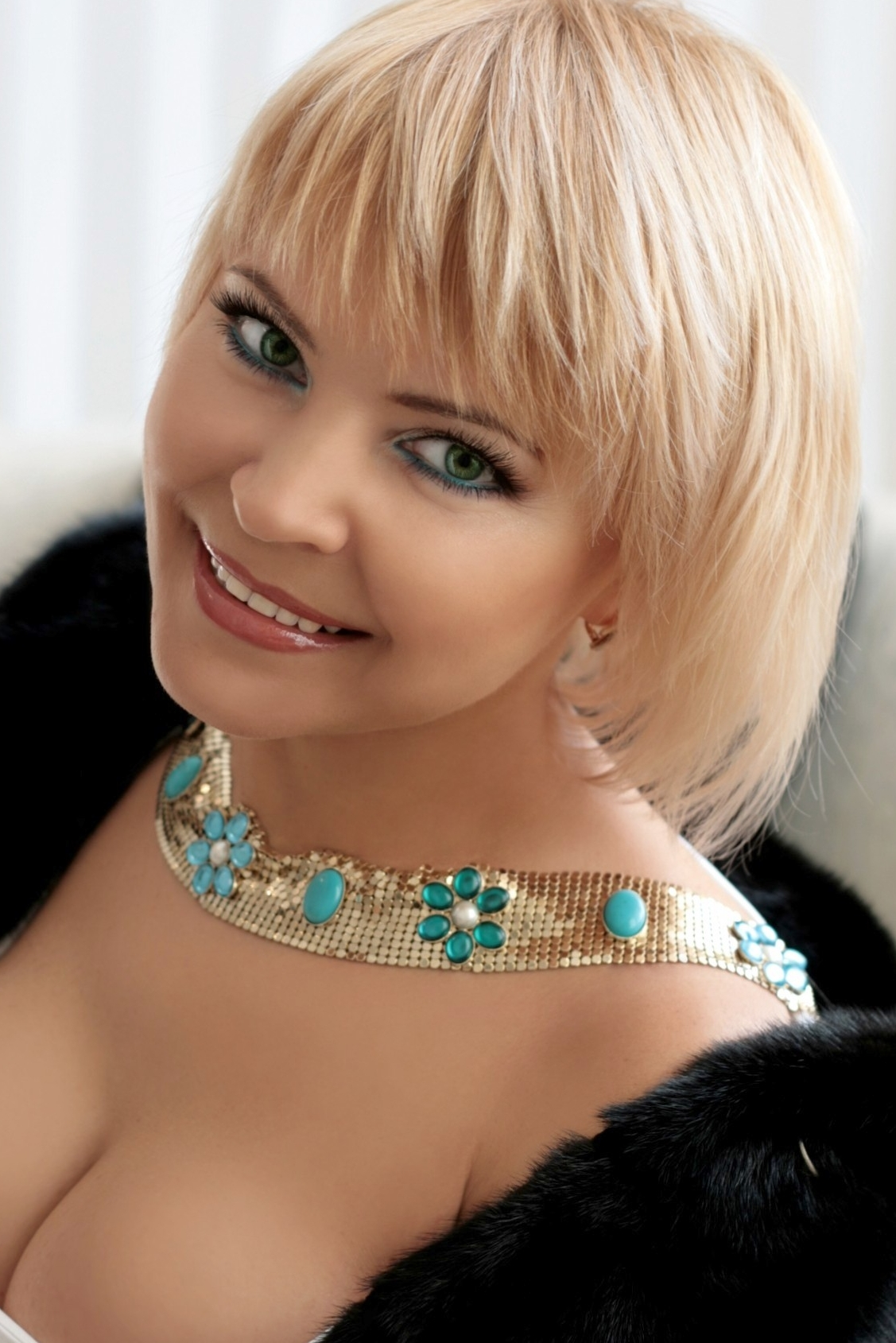 Ukrainian girl Natalia,50 years old with blue eyes and blonde hair.