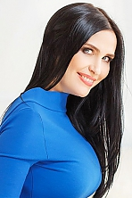 Ukrainian girl Natalia,44 years old with blue eyes and dark brown hair.
