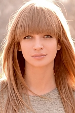 Ukrainian girl Olga,31 years old with blue eyes and blonde hair.