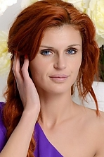 Ukrainian girl Marina,27 years old with green eyes and red hair.