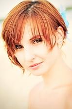 Ukrainian girl Tatiana,25 years old with green eyes and auburn hair.