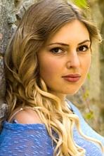 Ukrainian girl Viktoriya,21 years old with hazel eyes and light brown hair.