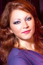Ukrainian girl Evgenia,30 years old with grey eyes and light brown hair.