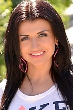 Ukrainian girl Oksana,36 years old with green eyes and dark brown hair.