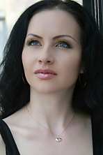 Ukrainian girl Natalia,33 years old with blue eyes and black hair.