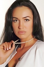 Ukrainian girl Ekaterina,35 years old with brown eyes and dark brown hair.