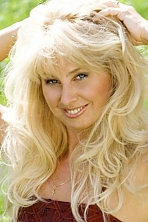 Ukrainian girl Nataliya,55 years old with blue eyes and blonde hair.