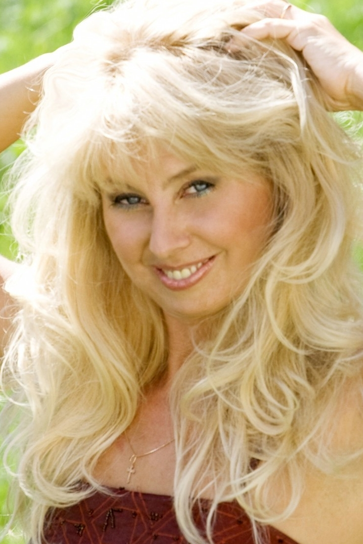Ukrainian girl Nataliya,55 years old with blue eyes and blonde hair.