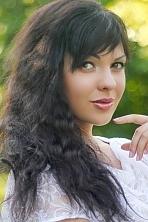 Ukrainian girl Julia,27 years old with brown eyes and black hair.